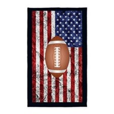 Football on american flag Area Rug