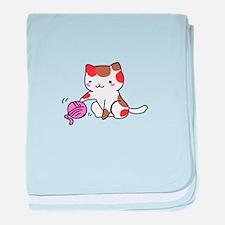 calico kitten with yarn baby blanket