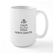 Keep calm you live in Tioga North Dakota Mugs