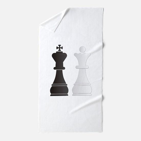 Black king white queen chess pieces Beach Towel