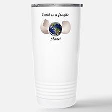 Earth is a fragile planet Travel Mug