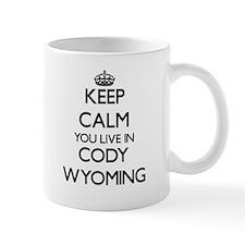 Keep calm you live in Cody Wyoming Mugs