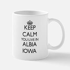 Keep calm you live in Albia Iowa Mugs