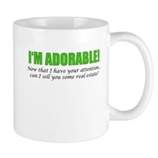 Im Adorable! Can I sell you some real estate? Mugs