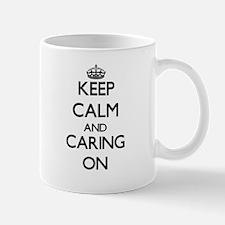 Keep Calm and Caring ON Mugs