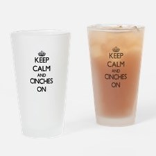 Keep Calm and Cinches ON Drinking Glass