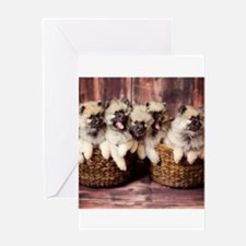 Puppies in baskets Greeting Cards
