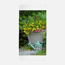 Spring flowers and watering can Beach Towel