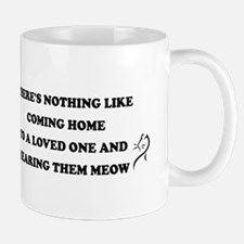 COMING HOME TO A LOVED ONE Mugs