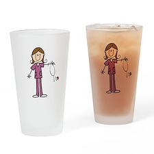 Brunette Female Nurse Drinking Glass