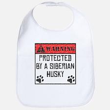 Protected By A Siberian Husky Bib