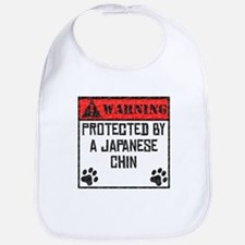 Protected By A Japanese Chin Bib