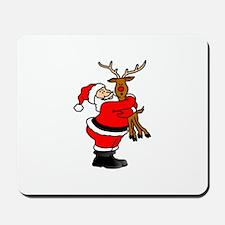 Santa hugging reindeer Mousepad