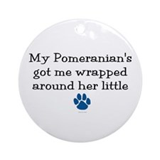 Wrapped Around Her Paw (Pomeranian) Ornament (Roun
