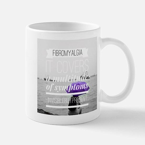 FM a multitude of symptoms Mugs