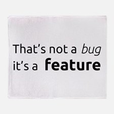 A feature is not a bug Throw Blanket