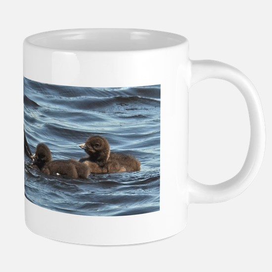 Loon feeding twins Mugs