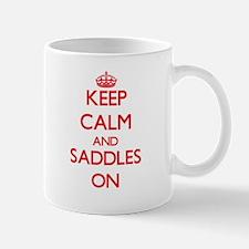 Keep Calm and Saddles ON Mugs