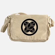 Intersecting hawk feathers in circle Messenger Bag