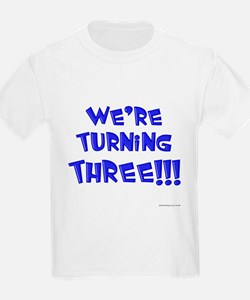 were_turning_three_blue T-Shirt