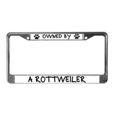 Owned by a Rottweiler License Plate Frame