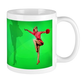 Vera-Ellen Dancing on green background Mugs