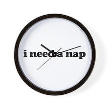 i need a nap Wall Clock