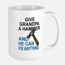 GIVE GRANDPA A HAMMER, AND HE CAN FIX ANYTHIN Mugs