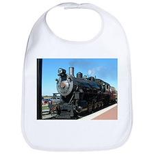 Steam train rolling along Bib