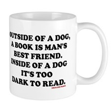 OUTSIDE OF A DOG, A BOOK IS MAN'S BEST  Mug