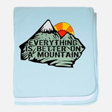 Everythings better on a mountain. baby blanket