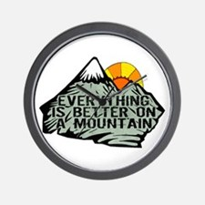 Everythings better on a mountain. Wall Clock