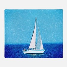 Sailboat at sea Throw Blanket