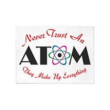 Never Trust An Atom 5'x7'Area Rug