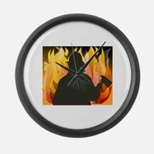 Firefighter silhouette against fl Large Wall Clock
