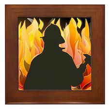 Firefighter silhouette against flames Framed Tile