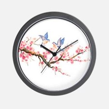 Watercolor pink cherry blossoms and blu Wall Clock