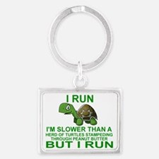 I RUN.  I'M SLOWER THAN A HERD  Landscape Keychain