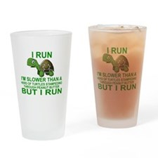 I RUN.  I'M SLOWER THAN A HERD OF T Drinking Glass