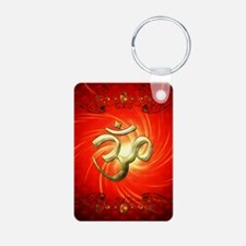 The sign om in gold Keychains