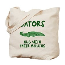 Gators hug with their mouths Tote Bag