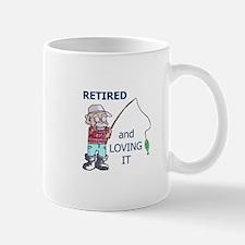 RETIRED AND LOVING IT Mugs