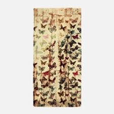 Grunge butterflies on wood Beach Towel