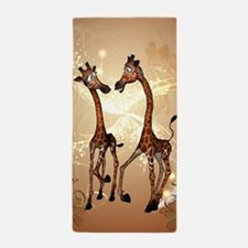 Funny cartoon giraffe Beach Towel