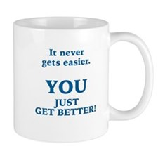 ENCOURAGEMENT - IT NEVER GETS EASIER - YOU GE Mugs