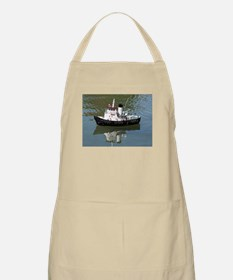 Model tugboat reflections in water Apron