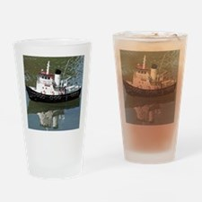 Model tugboat reflections in water Drinking Glass
