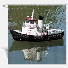 Model tugboat reflections in water Shower Curtain