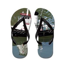 Model tugboat reflections in water Flip Flops