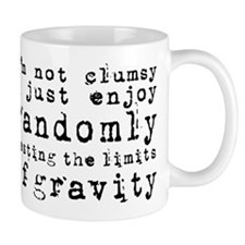 i'm not clumsy - black Mugs